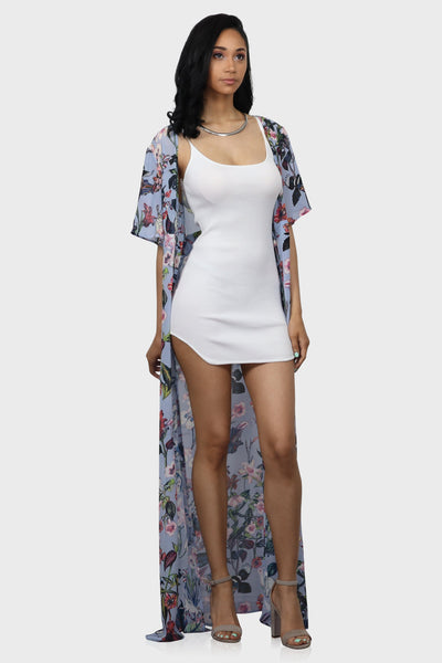 Floral kimono with short sleeves, cut out back and attached waist tie on model front view
