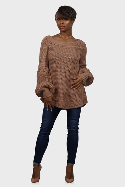 Tan heavy knitted off shoulder sweater with puff sleeves on model front view