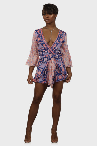 Floral tie front romper with three quarter length sleeves on model front view