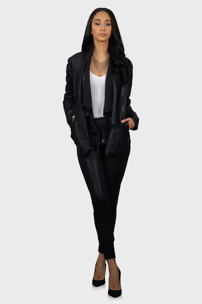 Black leather joggers with a high waist, side pockets and drawstring waist on model front view