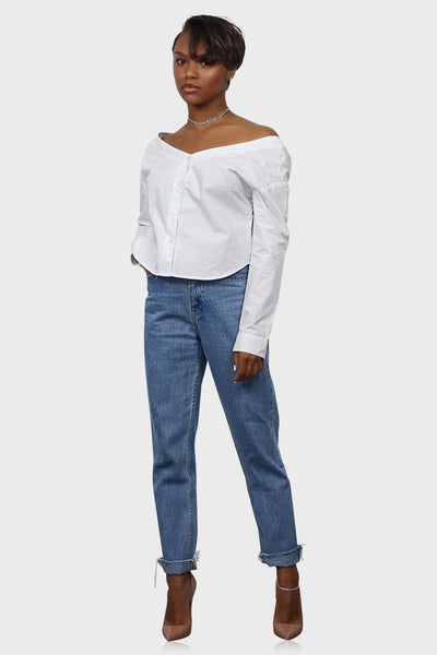 Off shoulder crop top white with long sleeves and button down closure on model front view