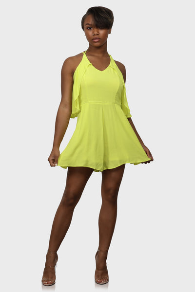Ruffle romper neon green with halter neckline on model front view