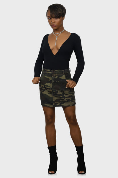 Denim camo mini skirt with pockets, belt hoops and a front zipper closure on model front view