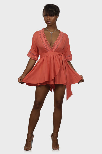 Wrap skirt romper with v neck and short sleeves on model front view