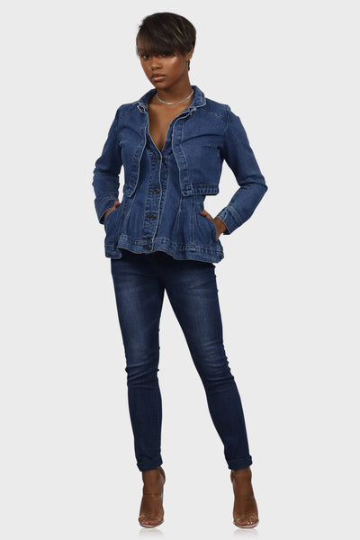Medium blue peplum denim jacket with pockets on model front view