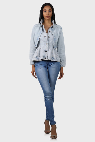 Light blue peplum denim jacket with side pockets on model front view