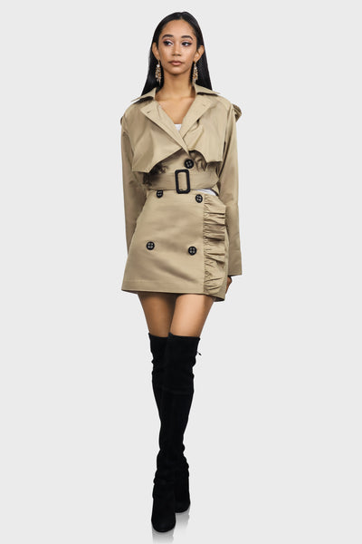 Khaki mini skirt with side ruffle detail, faux button details and a side zipper closure on model front view
