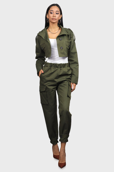 Olive cargo joggers with side pockets, an elasticated waistband and elasticated ankle cuffs on female model facing forward with one hand in pocket