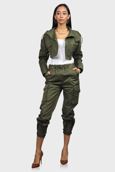 Olive crop jacket with button up front, mock neck and front pockets on model front view