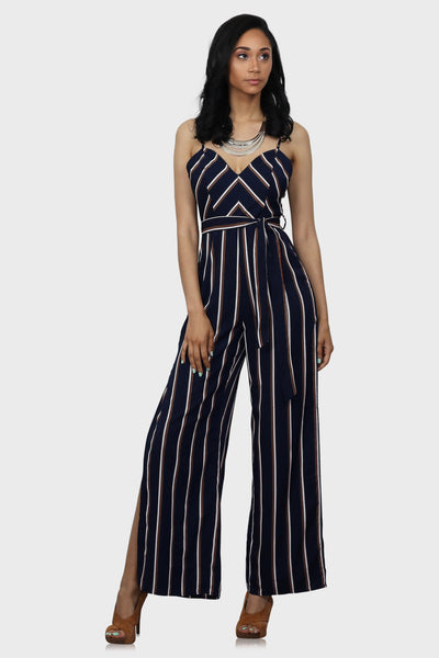 Blue women's striped jumpsuit with waist tie and side slits on model front view