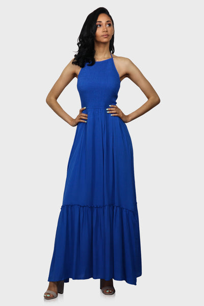 Open Back Dress with halter neckline and maxi length royal blue on model front view