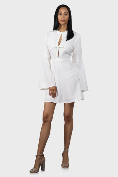 Bell sleeve dress white with cut out back on model front view