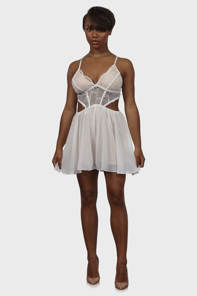 Off white lace romper with cutouts along the waist on model front view