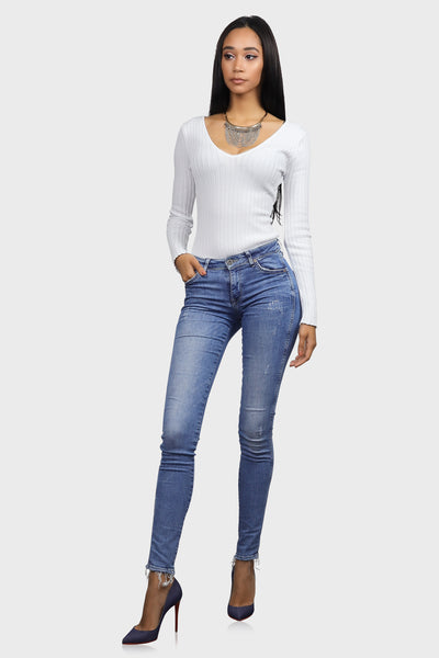 White long sleeve bodysuit with v neck and ribbed knit on model front view