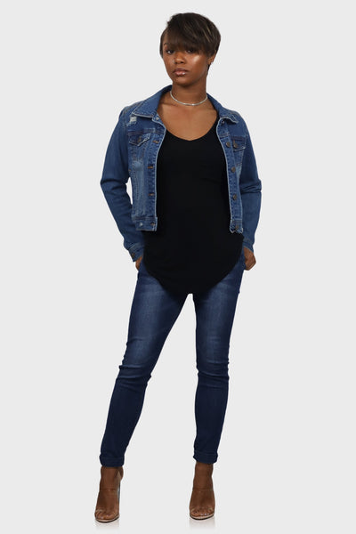 Medium wash cropped jean jacket on model front view