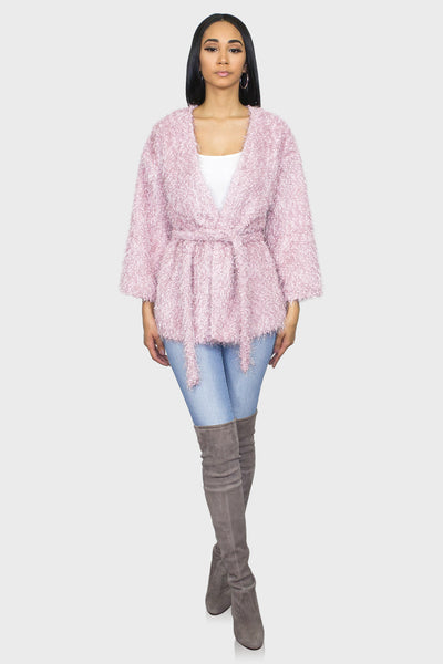 Belted fuzzy sweater in pink on model front view