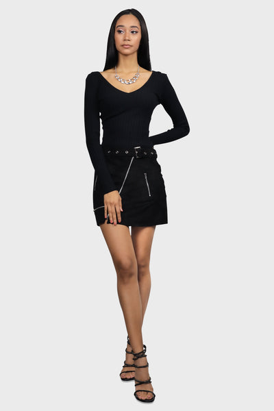 Black suede mini skirt with zipper details and an attached grommet belt on model front view