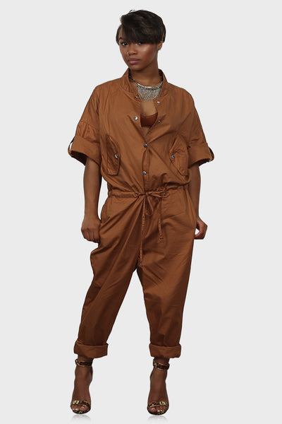 Women's utility jumpsuit rust on with button up front, drawstring waist and side pockets on model front view