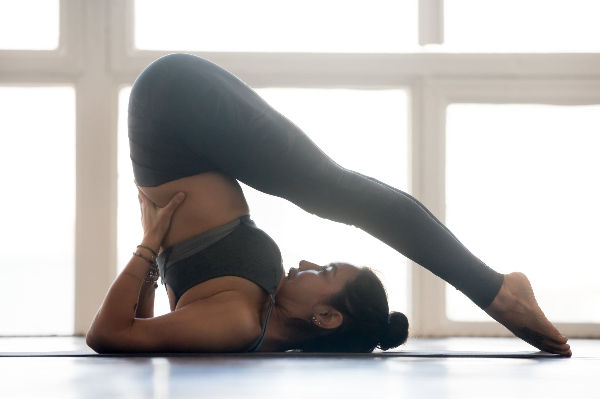 Do These 4 Yoga Poses in Bed to Help You Sleep