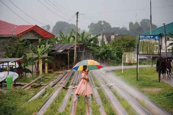 Young Woman with Umbrella, Nigeria, 2006.