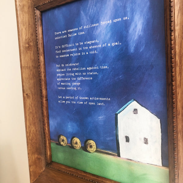 Close up of painting and poem Fallow Time featuring hay bales and white farm house