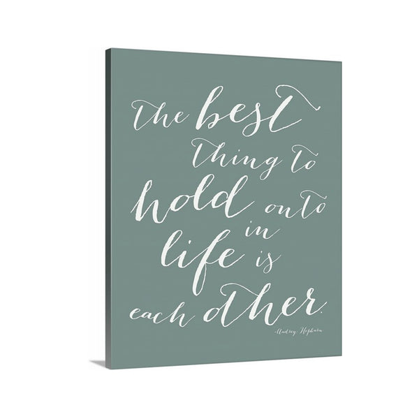 The Best THing to Hold onto in Life is Each Other Audrey Hepburn Quote on Canvas featured in Spa Green