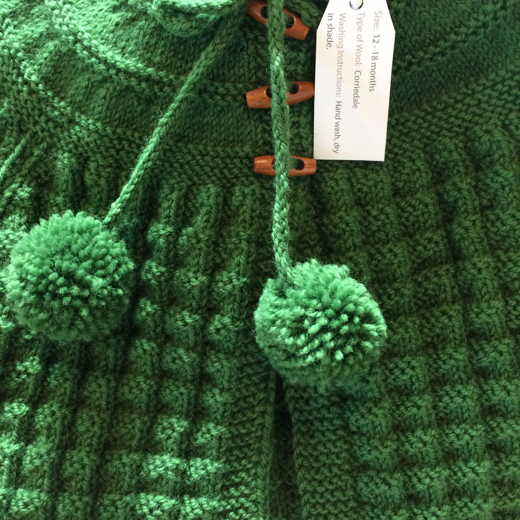 Hand Knitted Hooded Jacket with Pom Poms