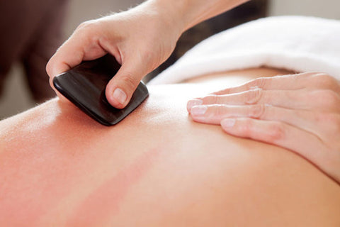 gua sha massage and tool