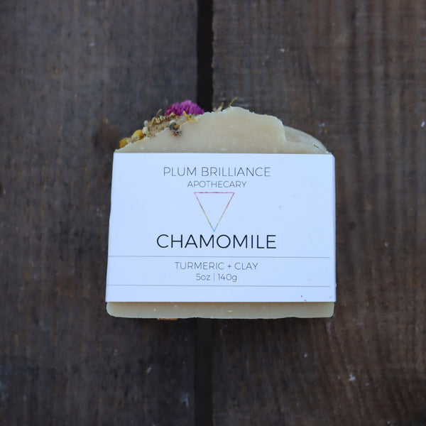 chamomile bar soap on wood crate