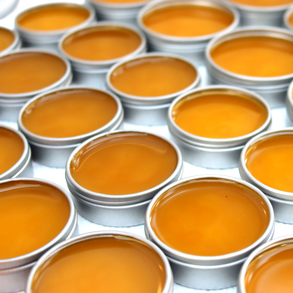 just poured tins of warming salve handcrafted in San Diego county