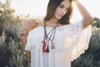 Model Wearing Mala Necklaces - Rose Quartz, Carnelian, Agate, Sandalwood