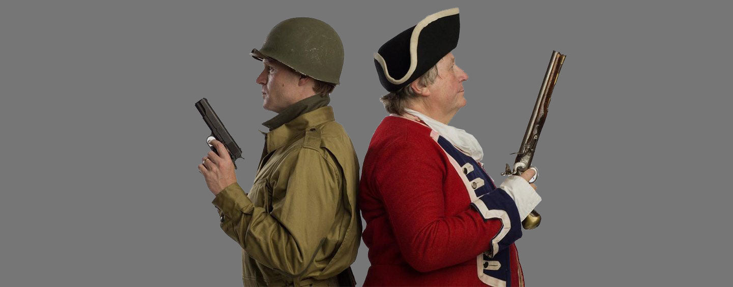 Christian and Alex Cranmer posing in vintage military uniforms with period-appropriate firearms
