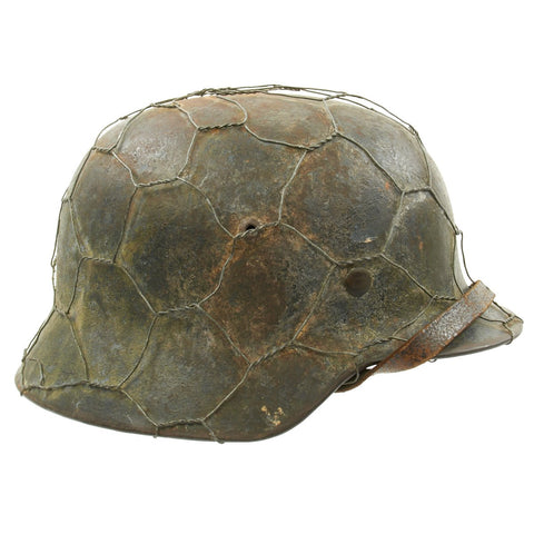 Original German WWII M35 Helmet with Chicken Wire and Camouflage Paint - ET64