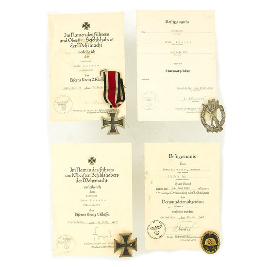 Original German WWII Set of 4 Awards with Documents named to Lt. Erwin Lusche of 293rd Artillery Regt. Original Items