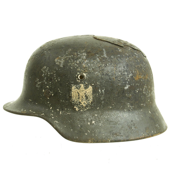 Original German WWII M40 Heer Single Decal Russian Front Battlefield Pickup Helmet - marked ET66 Original Items