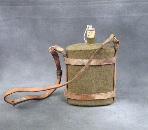 Original British Army Water Bottle in Leather Skeletal Carrier