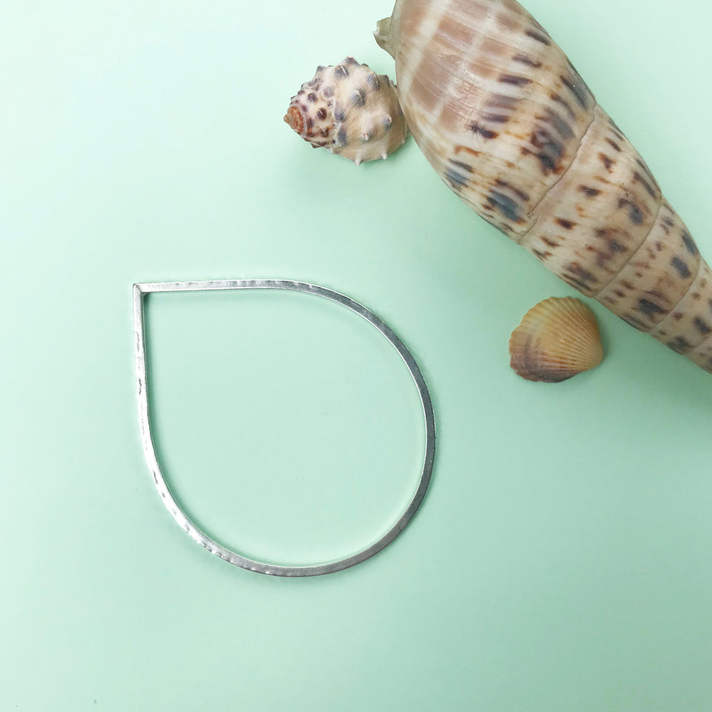 sterling silver dewdrop bangle with hammered texture finish, made by Ami of AB Jewellery, Goldsmith
