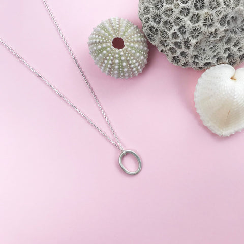 sterling silver pebble pendant with matt finish and choice of chain lengths, made by Ami of AB Jewellery, Goldsmith
