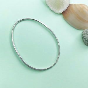 sterling silver pebble bangle with polished finish, made by Ami of AB Jewellery, Goldsmith