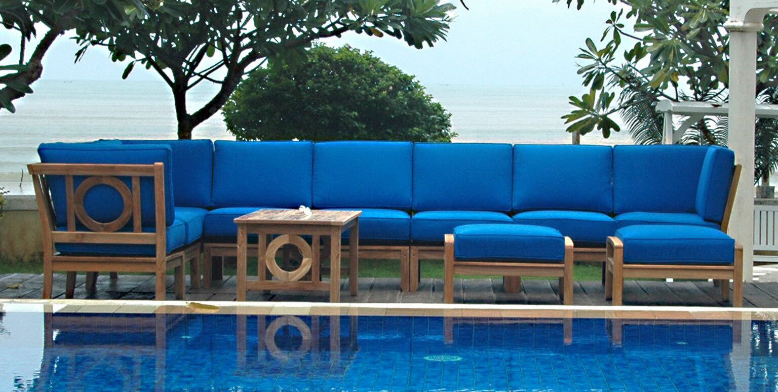 navy-blue sectional outdoor furniture at pool
