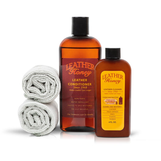Leather Honey leather cleaner and larger conditioner bottle with two lint free cleaning and conditioning cloths.