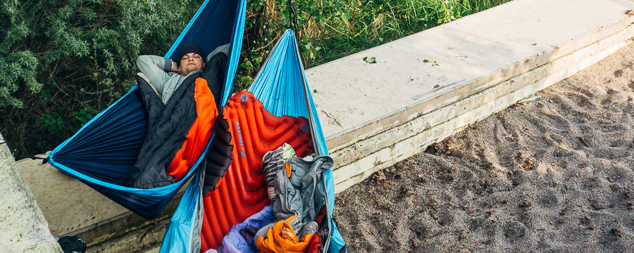 Man camps in a hammock