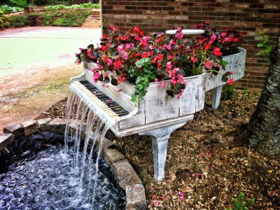 old-piano-turned-into-outdoor-water-fountain