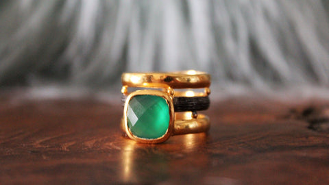 Golden and oxide metal with green stone ring