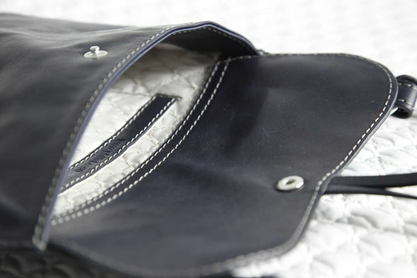 Philini Cowboy Bag dark blue made from natural leather with white inside lining.