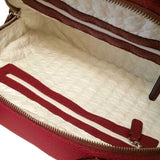Inside of the red bag Domi from Philini Collections.