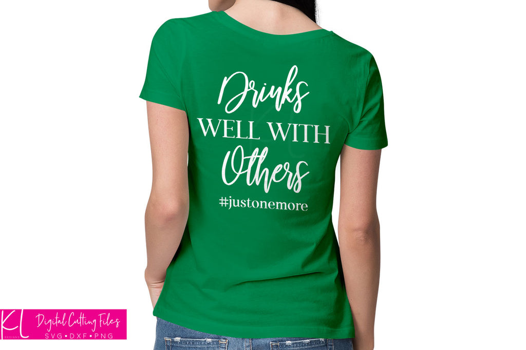 St. Patrick's Day shirt in green with the Drinks Well with Others svg quote on the back in white vinyl