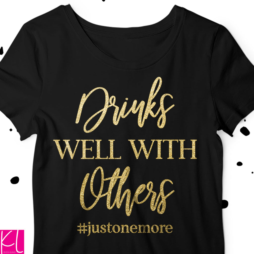 Drinks Well with Others svg quote on a black t-shirt for a night on the town with the girls