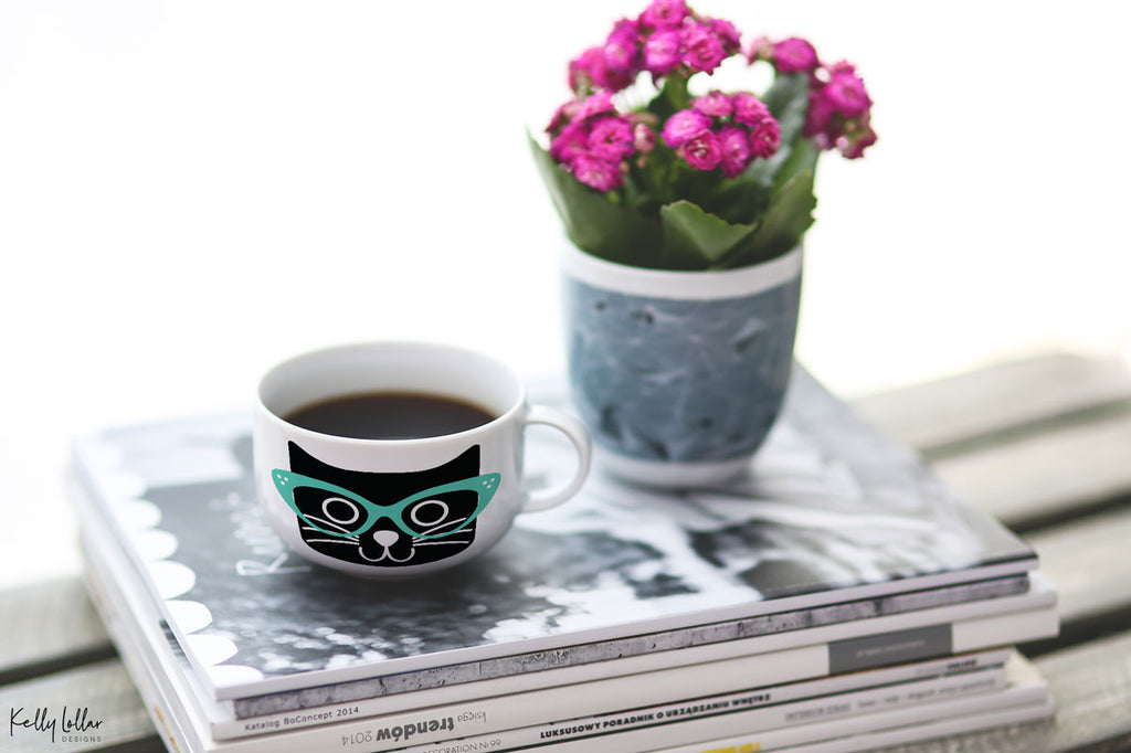 White coffee mug with the Cat with Glasses svg in black and mint