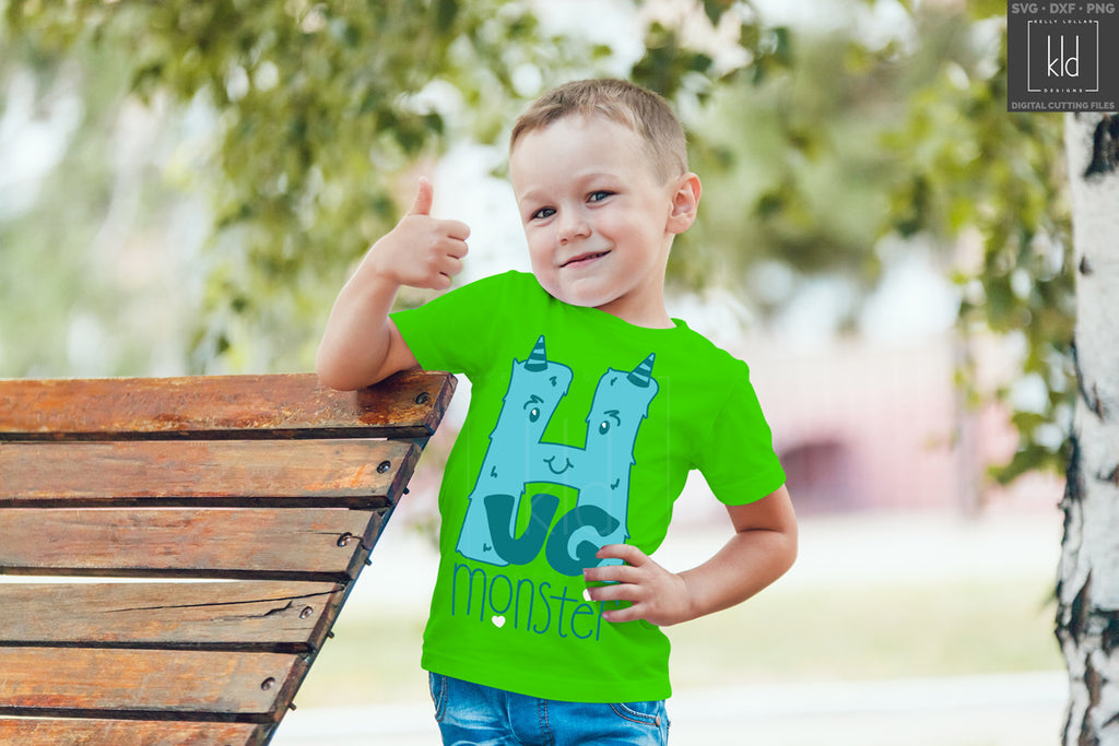 Green boy's shirt with the Hug Monster svg in blue